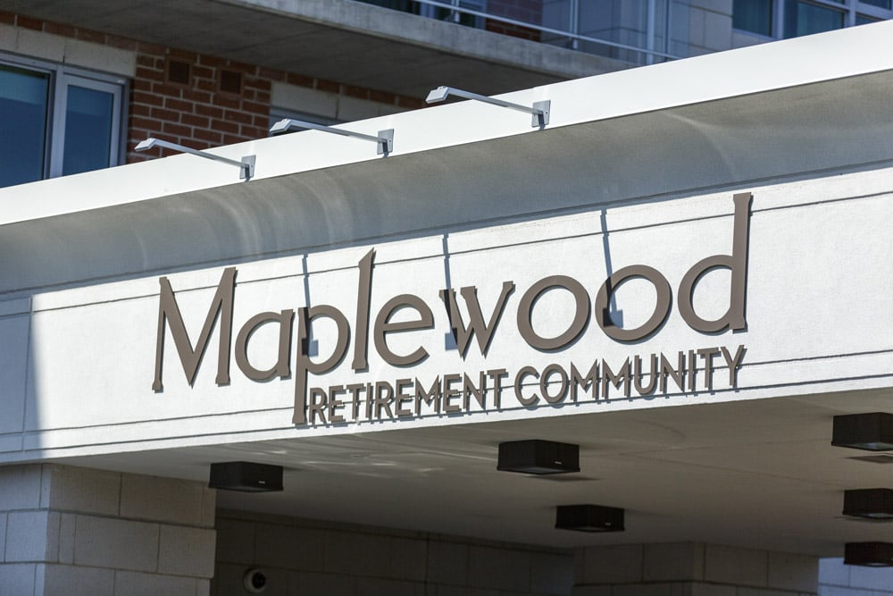 Maplewood Retirement Community Sign Out Front of Building